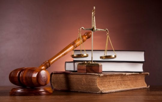 Scales of Justice on a book
